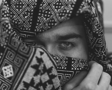 black and white close up image of a persons eyes