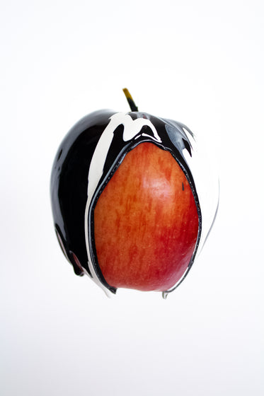 black and white paint on red apple