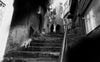 black and white photo of a worn city staircase