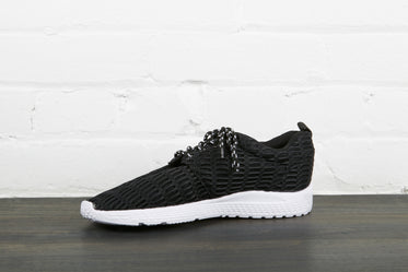 black and white running shoe