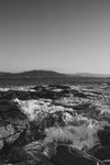 black and white waves on rocks