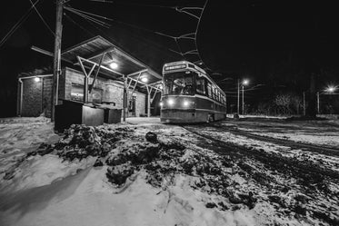 black and white winter street car