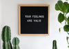 black board with white letters your feelings are valid