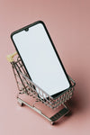 black cell phone in a small silver shopping cart
