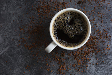 black coffee and spilled instant granules