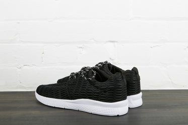 black sneakers with white sole