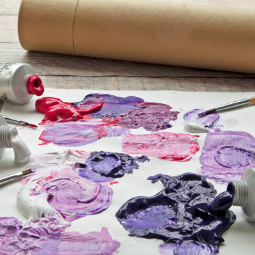 blobs of purple, red and white paint mixed together on paper