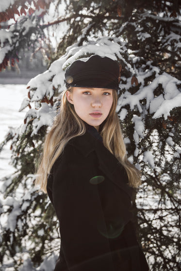 blond woman with winter pine