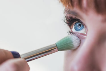 blue eyes getting makeup close up