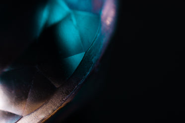 blue light shimmers on a gemstone