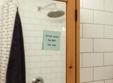 blue note on a bathroom mirror reads a positive message