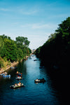 blue river with boaters in the water