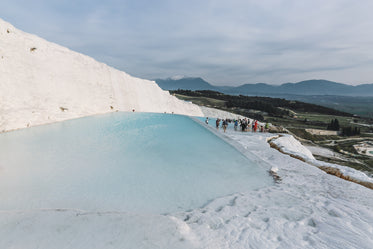 blue thermal pools contrasting countryside