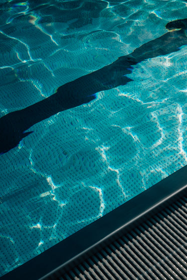 blue wavy water of a swimming pool