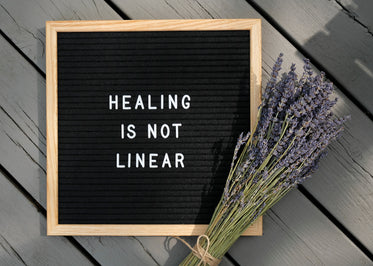 board with a positive message and bundle of lavender