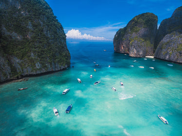 boats sail on clear blue water