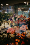 bouquets of flowers on display in window