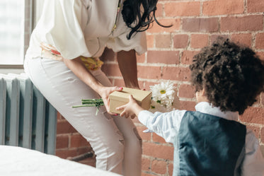 boy giving mom gifts for mothers day