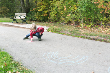 boy making sidewalk art
