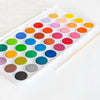 brand new watercolor set on white table