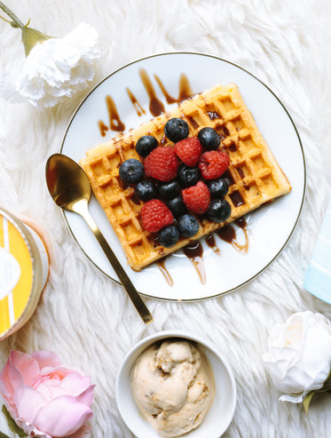 breakfast flatlay with fruit and waffles