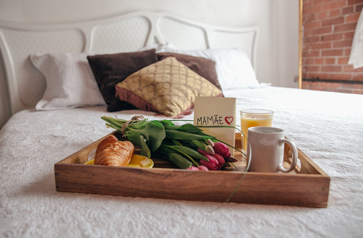 Breakfast On Bed With Flowers For Mom
