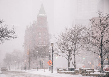 brick office building with turret in blizzard