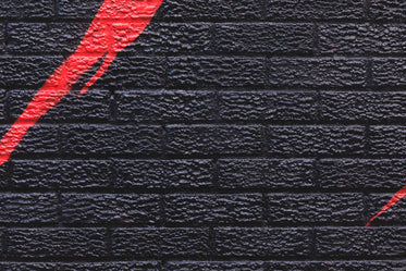 brick wall with graphic street art