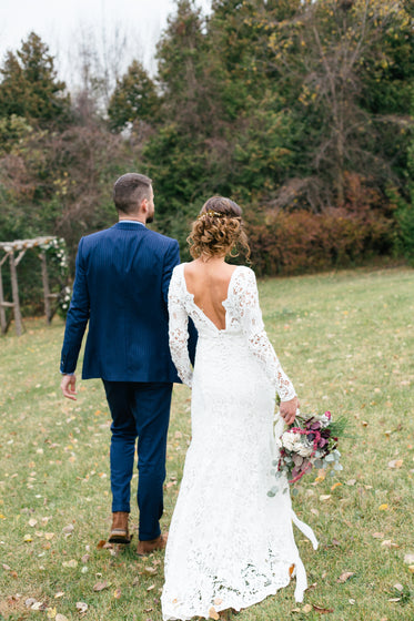 bride and groom walking on the grass