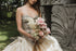 bride holding flowers in sculpture garden