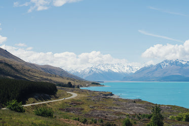 bright blue water and mountain side highway