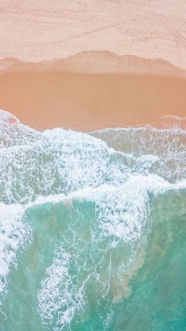 bright blue waters and red sandy shores