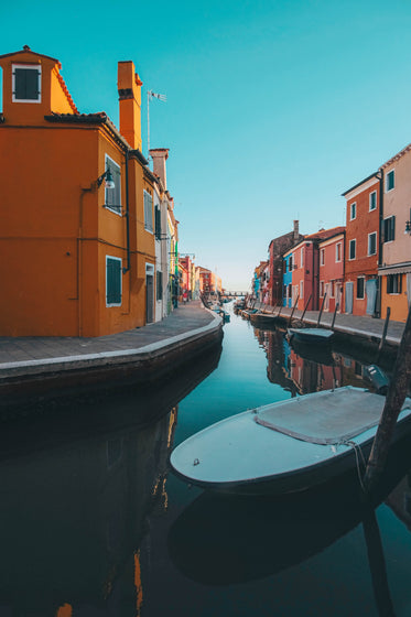 bright colorful buildings line a canal