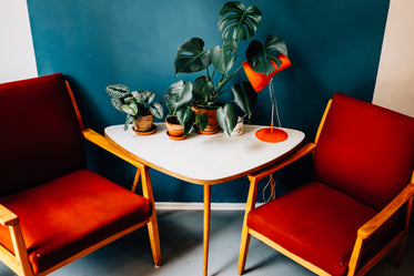 bright red chairs and white table