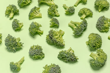 broccoli pieces on green surface