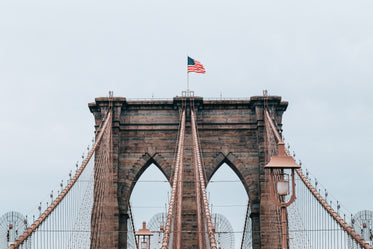 brooklyn bridge with flag