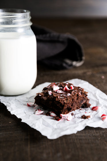 brownie with candy cane and milk