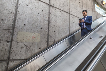 Picture of Businessman On Escalator - Free Stock Photo