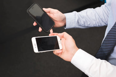 businessmen hold blank iphone