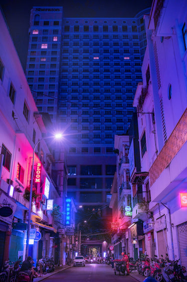 busy city street in blue and pink light
