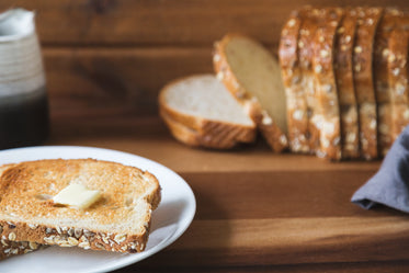 buttered toast on cutting board
