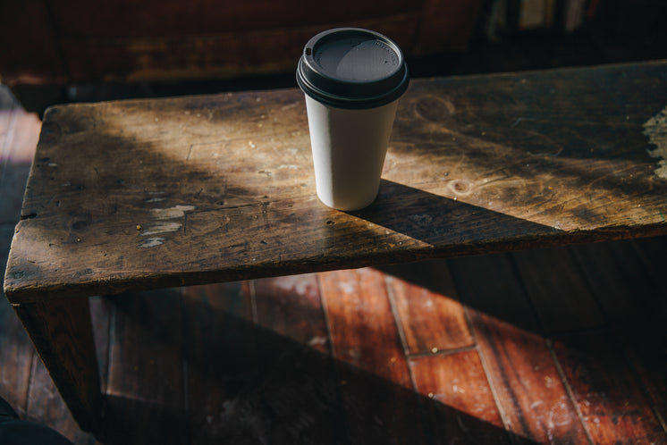 cafe-cup-on-wood-table.jpg?width=746&for