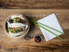camera looks down on wooden table with two bao buns