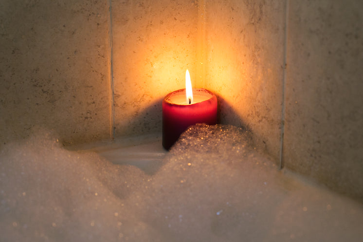 Candle Burning By Bubble Bath