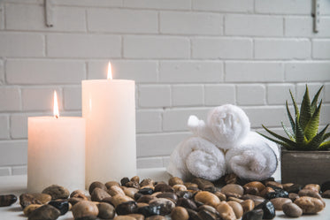 candles stones and towels