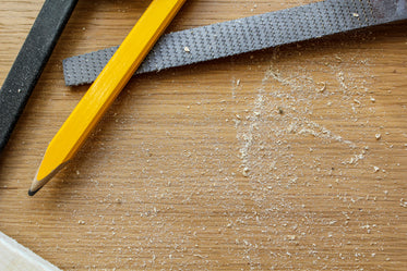 carpenter's pencil and tools in sawdust
