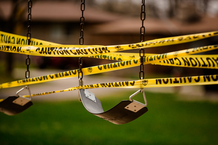 Caution Tape Wrapped Around Empty Swings