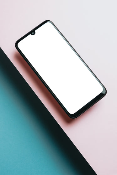 cellphone floats above pink with blue below