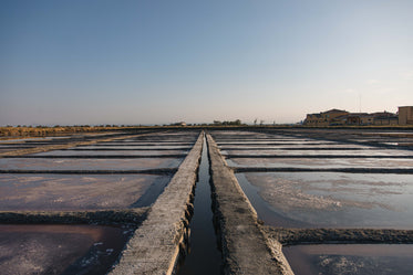 cement grid with pools of water and salt