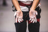 chalk covered hands in rock climbing gear